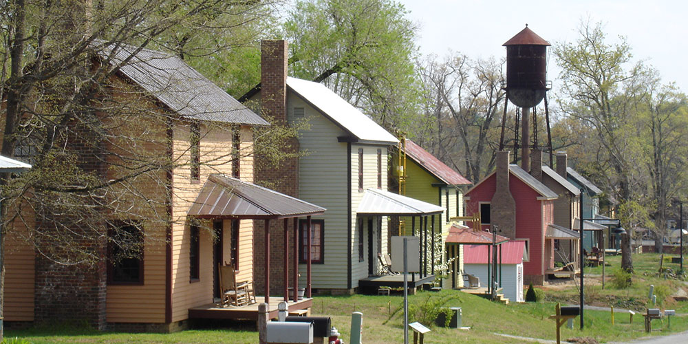 Restored mill houses line the streets in Glencoe along the MST on the Haw River. | Photo © Preservation NC